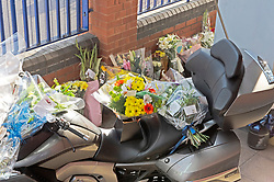 ©Licensed to London News Pictures 28/09/2020  <br /> Croydon, UK. Sgt Ratana's motorbike covered in flowers. Flowers for Sgt Matt Ratana at Croydon Custody Centre. The murder investigation continues after the death of police sergeant Matt Ratana at the Croydon Custody Centre in South London last week. Photo credit:Grant Falvey/LNP