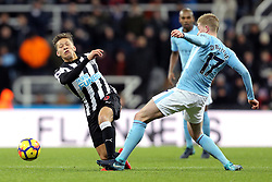 Newcastle United's Dwight Gayle (left) and Manchester City's Kevin De Bruyne (right) battle for the ball during the Premier League match at St James' Park, Newcastle.