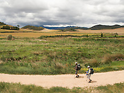 Across the plains of Navarra, two walkers tread along the Camino de Santiago. The open land and mountains with the cool walking weather was a wonderful part of the Way of Saint James in Northern Spain.
