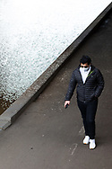 Melbournians wearing masks enjoy their one hour outdoors in the CBD. (Photo by Dave Hewison/Speed Media)
