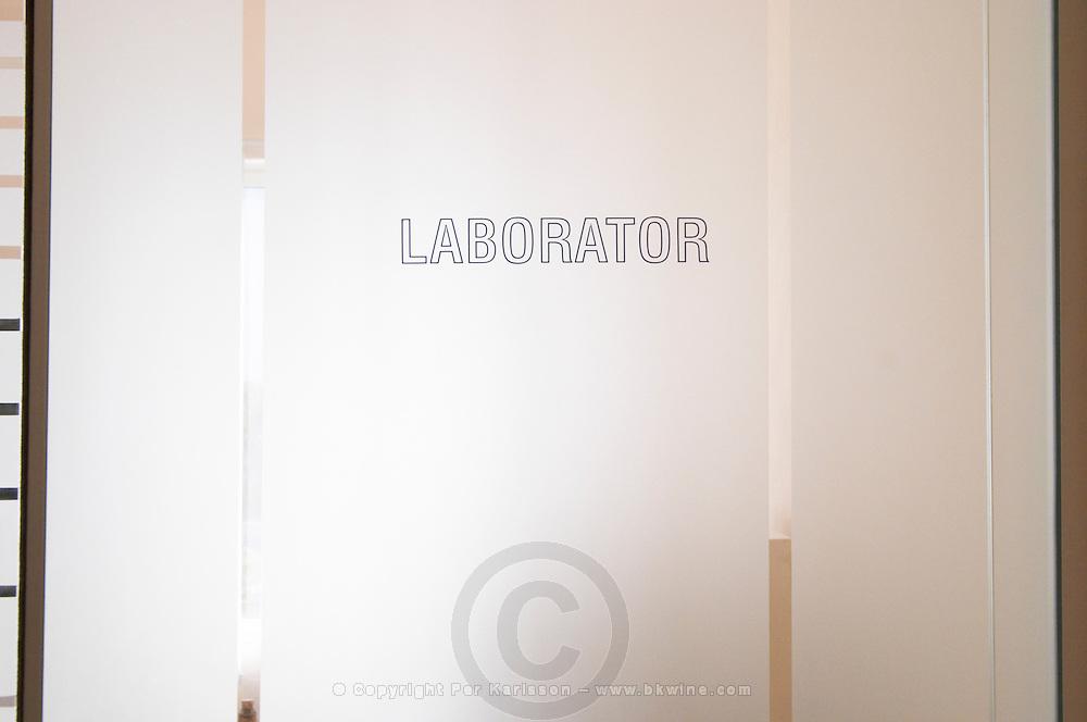 The door to the laboratory department. Frosted glass with text Laborator. Kantina e Pijeve Gjergj Kastrioti Skenderbeu Skanderbeg winery, Durres. Albania, Balkan, Europe.