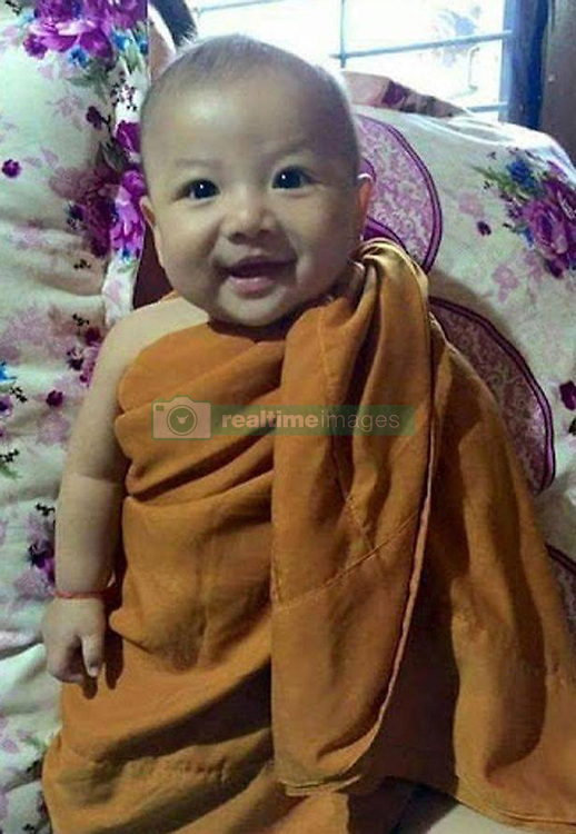 A newborn baby who staged a miracle recovery after being stabbed 14 times and buried alive is to be adopted..A newborn was rescued after he was found buried alive in a field in Wangyai district of Khon Kaen province..The person who discovered the baby, Kachit Krongyut, 53, said she was taking her six cows out to eat grass in the field when she heard voices. Then she noticed there was a spot that looked like it was recently dug up..She felt the soil with her hand and to her shock, a baby's foot emerged from the ground. So she quickly called her family to rescue the baby and send it to hospital..''At first, I thought someone buried their pets alive, but then I saw a foot. I tried to control myself and called for help. The baby was buried with its face facing down,'' Kajit said..Her husband Pornchai, who took part in the rescue, added the baby was buried in a 20 centimeter-deep hole. He noticed footsteps and nearby traces of a motorbike from the possible suspect, and has informed police..Wangyai Hospital doctors said the baby boy appeared to show signs of physical abuse with several bruises on his stomach. His condition was described as stable. Police believe the person who buried the baby was a resident in the area as the investigation is underway.Anupong Khotmanee/Exclusivepix Media (Credit Image: © Exclusivepix media via ZUMA Press)