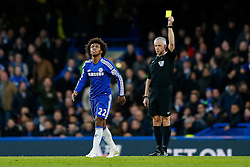 Willian of Chelsea is shown a yellow card by referee Chris Foy - Photo mandatory by-line: Rogan Thomson/JMP - 07966 386802 - 13/12/2014 - SPORT - FOOTBALL - London, England - Stamford Bridge - Chelsea v Hull City - Barclays Premier League.