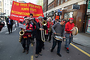 May Day celebrations in London, England, United Kingdom. Demonstration by unions and other organisations of workers to mark the annual May Day or Labour Day. Groups from all nationalities from around the World, living in London gathered to march to a rally in central London to mark the global workers day.