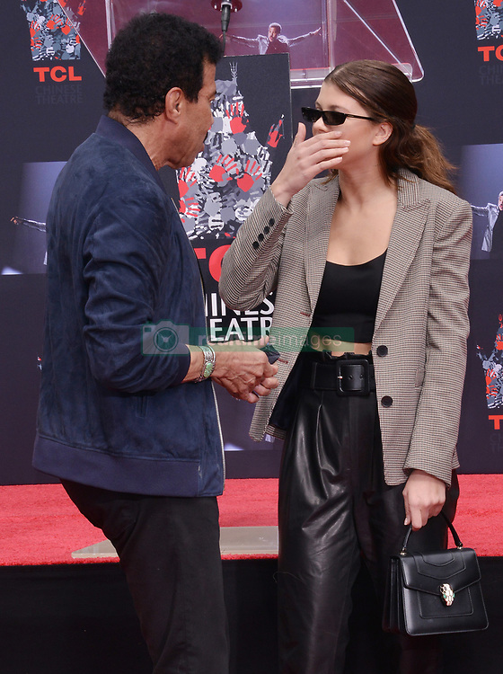 (L-R) Lionel Richie and Sofia Richie at the Lionel Richie Hand and Footprint Ceremony held at the TCL Chinese Theatre in Hollywood, CA  on Wednesday, March 7, 2018. (Photo By Sthanlee B. Mirador/Sipa USA)