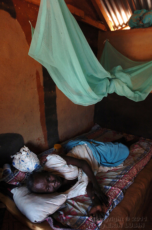 Atial Aballa Odolla, 80, from the Gambella region of Ethiopia, rests in her home at Ifo Refugee Camp in Dadaab, Kenya.September 15, 2006. ..Photograph by Erin Lubin