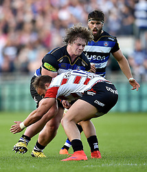 Nick Auterac of Bath Rugby takes on the Gloucester defence - Mandatory byline: Patrick Khachfe/JMP - 07966 386802 - 26/09/2015 - RUGBY UNION - The Recreation Ground - Bath, England - Bath Rugby v Gloucester Rugby - West Country Challenge Cup.