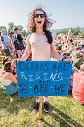 A man gives everything for his cause - Reaching the Sacred stones a giant human version of their hour glass logo is created - The Extinction Rebellion protest march around the site, led by their Iconic pink boat, Tell the Truth - The 2019 Glastonbury Festival, Worthy Farm. Glastonbury, 27 June 2019