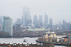 ©Licensed to London News Pictures 06/12/2019.<br /> Greenwich,UK. A cloudy view of the City of London from Greenwich Park. People out and about making the best of a cold and windy wet weather day at Greenwich Park, Greenwich, London.  Photo credit: Grant Falvey/LNP
