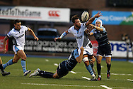 Ryan Wilson of Glasgow Warriors © fumbles the ball as he is tackled by Cory Allen and Matthew Morgan ® of the Cardiff Blues.  Guinness Pro12 rugby match, Cardiff Blues v Glasgow Warriors Rugby at the Cardiff Arms Park in Cardiff, South Wales on Friday 16th September 2016.<br /> pic by Andrew Orchard, Andrew Orchard sports photography.