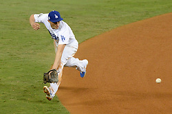 November 1, 2017 - Los Angeles, CA, United States - Dodgers Corey Seager, #5, was able to get this drive off of Astros Marwin Gonzalez during 4th inning action in game 7 at the World Series at Dodger Stadium Wednesday, November 1, 2017. (Credit Image: © David Crane/Los Angeles Daily News via ZUMA Wire)