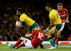 Samu Kerevi of Australia looks to offload despite the attentions of  Hadleigh Parkes of Wales<br /> <br /> Photographer Simon King/Replay Images<br /> <br /> Under Armour Series - Wales v Australia - Saturday 10th November 2018 - Principality Stadium - Cardiff<br /> <br /> World Copyright © Replay Images . All rights reserved. info@replayimages.co.uk - http://replayimages.co.uk