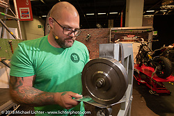 Jochen Lehman demonstrates his metal shaping skills in the Intermot Customized hall 10 during theIntermot International Motorcycle Fair. Cologne, Germany. Thursday October 4, 2018. Photography ©2018 Michael Lichter.