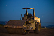 A steamroller at night on a road construction site outside Livermore, California.
