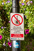 Sign warning about prosecution for drinking alcohol in public area, Newbury, Berkshire, England, UK
