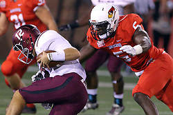 15 October 2016:  B.J. Bello swoops in to stop Josh Straughan.  NCAA FCS Football game between Southern Illinois Salukis and Illinois State Redbirds at Hancock Stadium in Normal IL (Photo by Alan Look)