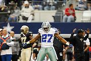 Dallas Cowboys strong safety Eric Frampton (27) celebrates after stoping the New Orleans Saints drive at Cowboys Stadium in Arlington, Texas, on December 23, 2012.  (Stan Olszewski/The Dallas Morning News)