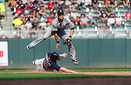 Gordon Beckham #15  of the Chicago White Sox leaps over Chris Parmelee #27 of the Minnesota Twins while turning a double play on September 16, 2012 at Target Field in Minneapolis, Minnesota.  The White Sox defeated the Twins 9 to 2.  Photo: Ben Krause