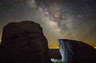 Ancient boulders litter the fields atop Spruce Knob, West Virginia's highest point.  These two monolithic remnants of old Earth sit beneath the even older Milky Way, whose light represents a far distant past and possible futures, while a faint glow exists between the two worlds, melding the past, present and futures of this infinite cosmic timeline.