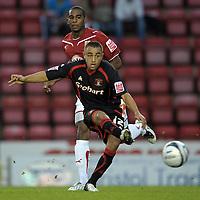 Tom Taiwo of Carlisle United and Bristol City's Marvin Elliott<br /> Bristol City vs Carlisle<br /> Carling Cup Round 2, Ashton Gate, Bristol, UK<br /> 26/08/2009. Credit Colorsport/Dan Rowley<br /> Football
