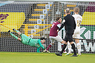 Milton Keynes Dons goalkeeper Lee Nicholls (1)  makes a save during the FA Cup match between Burnley and Milton Keynes Dons at Turf Moor, Burnley, England on 9 January 2021.