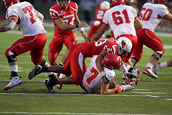 19 September 2009: Austin Davis takes down quarter back Trent Caffee in a game which the Austin Peay Governors were defeated 38-7 by the Illinois State Redbirds at Hancock Stadium on campus of Illinois State University in Normal Illinois