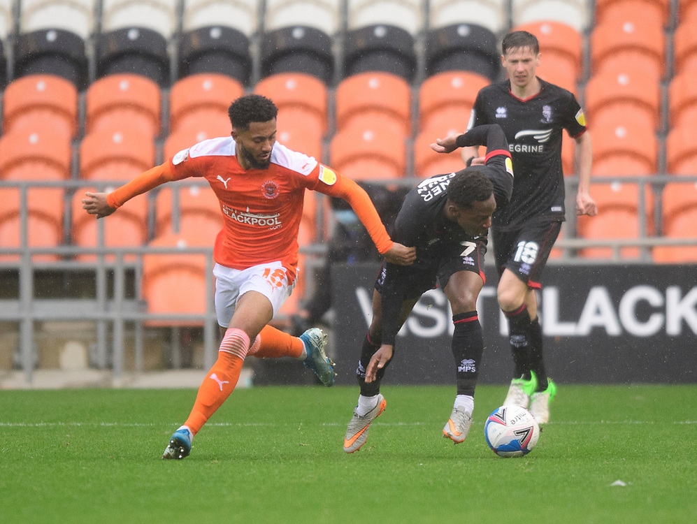 Lincoln City's Tayo Edun battles with Blackpool's Grant Ward<br /> <br /> Photographer Chris Vaughan/CameraSport<br /> <br /> The EFL Sky Bet League One - Blackpool v Lincoln City - Saturday 3rd October 2020 - Bloomfield Road - Blackpool<br /> <br /> World Copyright © 2020 CameraSport. All rights reserved. 43 Linden Ave. Countesthorpe. Leicester. England. LE8 5PG - Tel: +44 (0) 116 277 4147 - admin@camerasport.com - www.camerasport.com