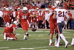 NORMAL, IL - September 01: Matt Biegalski holds the ball for extra point kicker Sam Fenlason during a college football game between the ISU (Illinois State University) Redbirds and the Saint Xavier Cougars on September 01 2018 at Hancock Stadium in Normal, IL. (Photo by Alan Look)