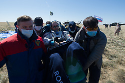 Expedition 62 crew member Oleg Skripochka of Roscosmos is carried to an All Terrain Vehicle (ATV) shortly after he and NASA astronauts Jessica Meir, and Andrew Morgan landed in their Soyuz MS-15 spacecraft near the town of Zhezkazgan, Kazakhstan on Friday, April 17, 2020. Meir and Skripochka returned after 205 days in space, and Morgan after 272 days in space. All three served as Expedition 60-61-62 crew members onboard the International Space Station.<br /> <br /> Where: Zhezkazgan, Kazakhstan<br /> When: 17 Apr 2020<br /> Credit: NASA/GCTC/Andrey Shelepin/Cover Images<br /> <br /> **Editorial use only**