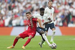 LONDON, ENGLAND - JULY 07: Denmark's Joakim Mæhle (L) and England's Bukayo Saka during the UEFA Euro 2020 Championship Semi-final match between England and Denmark at Wembley Stadium on July 07, 2021 in London, England. (Photo by Alex Morton - UEFA)