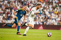 Real Madrid's player Sergio Ramos and Celta de Vigo's player John Guidetti during a match of La Liga Santander at Santiago Bernabeu Stadium in Madrid. August 27, Spain. 2016. (ALTERPHOTOS/BorjaB.Hojas)