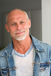 portrait of a good looking mature man looking at camera