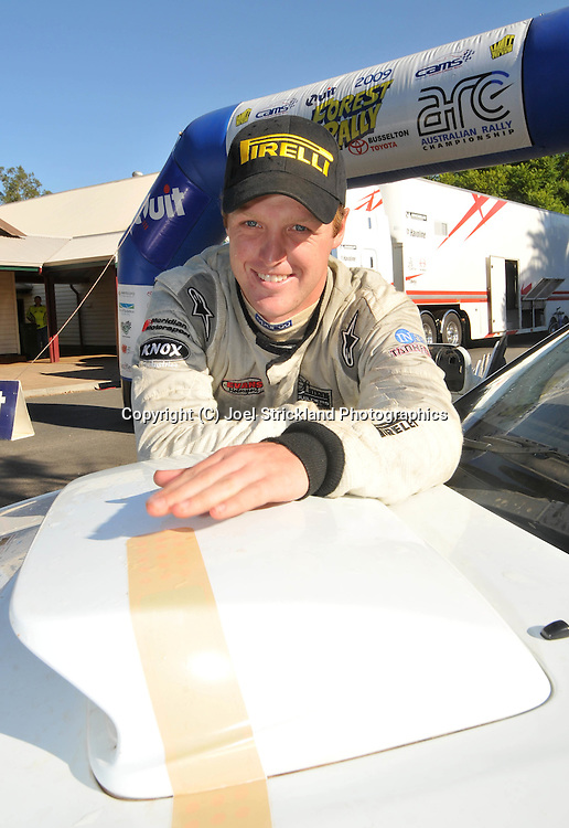 Eli Evans with his band aid for his car .Motorsport-Rally/2009 Forest Rally .Heat 2.5th of April 2009.Nannup, Western Australia.(C) Joel Strickland Photographics