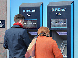 """Embargoed to 0001 Tuesday June 27 File photo dated 27/04/16 of people using cash machines outside a branch of Barclays bank in central London, as the cash machine celebrates its 50th birthday on Tuesday - with the """"hole in the wall"""" remaining a popular way for people to manage their day-to-day money half a century after it first appeared on the UK's streets."""