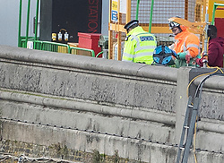 © Licensed to London News Pictures. 14/12/2019. London, UK. Police and other emergency services are seen at the Thames Tideway sewer works building site on The River Thames after a controlled explosion was carried out on a WW2 unexploded bomb. Photo credit: Peter Macdiarmid/LNP
