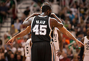 Spurs center DeJuan Blair (45) convenes with forward Tim Duncan before the opening tipoff of the NBA basketball game between the Utah Jazz and the San Antonio Spurs at Energy Solutions Arena, Wednesday, Dec. 12, 2012.