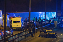 © Licensed to London News Pictures. 01/04/2020. Gerrards Cross, UK. An overturned HGV on the northbound carriageway between J1 and J2 and a damaged car on the southbound carriageway of the M40 motorway between J2 and J1a. The M40 motorway was closed in both directions due to a Road Traffic collision involving a heavy goods vehicle and at least to cars. Photo credit: Peter Manning/LNP