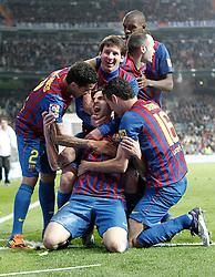 10-12-2011 VOETBAL: REAL MADRID - BARCELONA: MADRID<br /> Cesc Fabregas celebrates wth Lionel Messi, Daniel Alves, Andres Iniesta and Eric Abidal during La Liga Match<br /> ***NETHERLANDS ONLY***<br /> ©2011-FRH- NPH/Alvaro Hernandez
