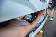 De VeloX IV wordt dichtgemaakt voor de recordpoging met Rik Houwers. Hij zou het niet halen, onder andere door de weersomstandigheden. Op de foto is het scherm te zien waarmee de fietser de weg ziet. In Duitsland probeert het Human Power Team Delft en Amsterdam (HPT), dat bestaat uit studenten van de TU Delft en de VU Amsterdam, het uurrecord te verbreken op de Dekrabaan met de VeloX4. Dat staat momenteel op 90,4 km. In september wil het HPT daarna een poging doen het wereldrecord snelfietsen te verbreken, dat nu op 133 km/h staat tijdens de World Human Powered Speed Challenge.<br /> <br /> Rider Rik Houwers at his attempt to set a new hour record. He wouldn't make it, partially because of the weather. The Human Power Team Delft and Amsterdam, consisting of students of the TU Delft and the VU Amsterdam, tries to set a new hour record on a bicycle with the special recumbent bike VeloX4. The current record is 90,4 km. They also wants to set a new world record cycling in September at the World Human Powered Speed Challenge. The current speed record is 133 km/h.