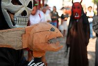 """MEXICO, Veracruz, Tantoyuca, Oct 27- Nov 4, 2009. Costumed """"xantolo"""" dancers wait their turn to practice in Tantoyuca's """"Plaza Constitucion."""" """"Xantolo,"""" the Nahuatl word for """"Santos,"""" or holy, marks a week-long period during which the whole Huasteca region of northern Veracruz state prepares for """"Dia de los Muertos,"""" the Day of the Dead. For children on the nights of October 31st and adults on November 1st, there is costumed dancing in the streets, and a carnival atmosphere, while Mexican families also honor the yearly return of the souls of their relatives at home and in the graveyards, with flower-bedecked altars and the foods their loved ones preferred in life. Photographs commissioned by HOY newspaper for a feature story."""