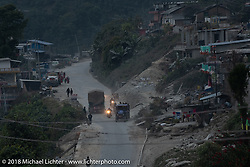 Jonathan Pite, Dave Nolan and Kiwi Mike Tomas riding into a mountain village where we regrouped before riding down a windy mountain road to our destination on day-7 of our Himalayan Heroes adventure riding from Tatopani to Pokhara, Nepal. Monday, November 12, 2018. Photography ©2018 Michael Lichter.