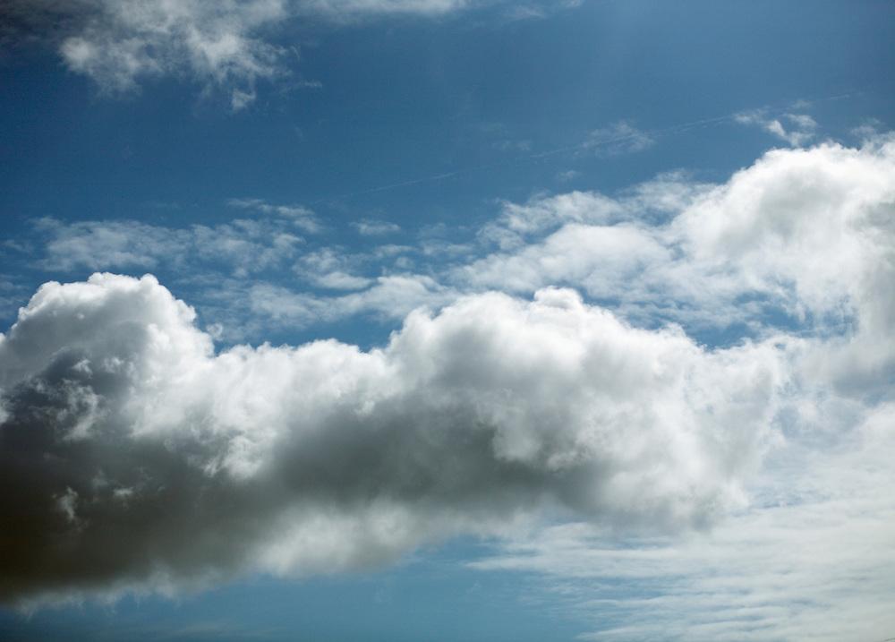Clouds float in blue skies.
