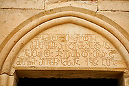 Close up picture & image of a Georgian inscription on the main entrance to David Gareja Georgian Orthodox monastery, Mount Gareja, Kakheti Region, Georgia (country)<br /> <br /> Founded in the 6th century by David (St. David Garejeli), one of the  thirteen Assyrian monks who built monasteries throughout Georgia. The monastery is spread out over a huge area of the arid Mount Gareja, with small cells and chapels cut into cliff faces .<br /> <br /> Visit our MEDIEVAL PHOTO COLLECTIONS for more   photos  to download or buy as prints https://funkystock.photoshelter.com/gallery-collection/Medieval-Middle-Ages-Historic-Places-Arcaeological-Sites-Pictures-Images-of/C0000B5ZA54_WD0s<br /> <br /> Visit our REPUBLIC of GEORGIA HISTORIC PLACES PHOTO COLLECTIONS for more photos to browse, download or buy as wall art prints https://funkystock.photoshelter.com/gallery-collection/Pictures-Images-of-Georgia-Country-Historic-Landmark-Places-Museum-Antiquities/C0000c1oD9eVkh9c
