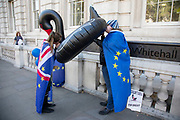 Anti-Brexit protesters wearing European Union flags blow up an inflatable black swan outside the Cabinet Office in Westminster on 17th September 2019 in London, England, United Kingdom. The swan signifies Operation Black Swan which refers to the worst-case-scenario planning for a No deal Brexit.