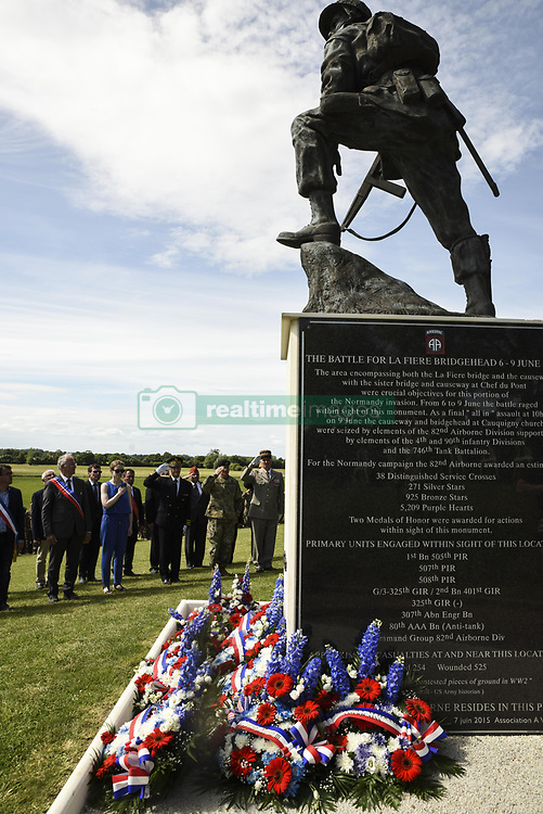 """Jun 4, 2017 - Sainte-Mere-Eglise, France - 'There are moments in a nation's history when its future course is decided by a chosen few who walked bravely into the valley of the shadow of death,' Army Gen. Curtis M. Scaparrotti said during a wreath-laying ceremony at the Iron Mike Memorial here yesterday. """"In such moments, young men and women pledge their lives so that their nation can live,"""" said NATO's supreme allied commander for Europe and the commander of U.S. European Command. PICTURED: U.S., German and French dignitaries salute as 'Taps' is played during an """"Iron Mike"""" wreath-laying ceremony in Sainte-Mere-Eglise, France, June 4, 2017. The ceremony commemorated the 73rd anniversary of the D-Day landings. (Credit Image: ? Tamika Dillard/Army/DOD via ZUMA Wire/ZUMAPRESS.com)"""