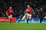 Aaron Shingler of Wales, with bloodied face evades tackle from England's Danny Care and makes a break towards the try line in the 2nd half. England v Wales, NatWest 6 nations 2018 championship match at Twickenham Stadium in Middlesex, England on Saturday 10th February 2018.<br /> pic by Andrew Orchard, Andrew Orchard sports photography
