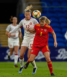 CARDIFF, WALES - Tuesday, April 13, 2021: Denmark's Stine Larsen (L) challenges for a header with Wales' Gemma Evans during a Women's International Friendly match between Wales and Denmark at the Cardiff City Stadium. (Pic by David Rawcliffe/Propaganda)