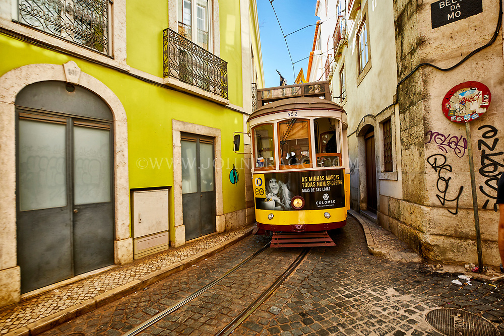 A trolley moves through the Alfama neighborhood of Lisbon, Portugal
