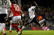 Floyd Ayite of Fulham (R) shoots and scores his team's first goal. EFL Skybet championship match, Fulham v Barnsley at Craven Cottage in London on Saturday 23rd December 2017<br /> pic by Steffan Bowen, Andrew Orchard sports photography.
