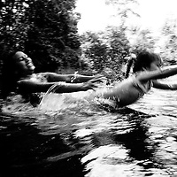 A mother and daughter play in a swimming hole near Puerto Asis, Putumayo. Many rivers in the region have been polluted by chemicals used in the ariel fumigation of coca plantations. The chemicals seep through the soil and contaminate the water, contact with this water can cause skin and eyesight problems.<br />
